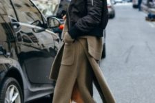 With puffer jacket and black ankle boots