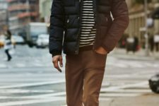 With puffer jacket, straight pants and boots