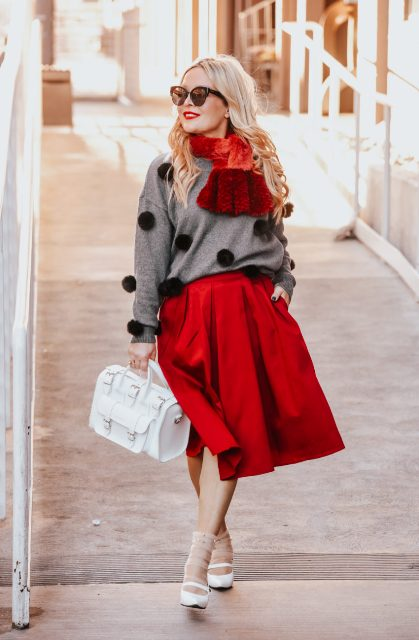 With red midi skirt, white bag and white shoes