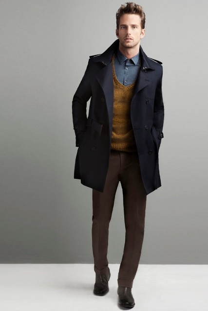 With shirt, navy blue coat, brown pants and boots