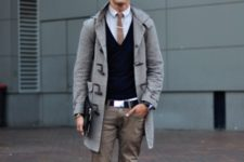 With shirt, tie, gray coat, beige pants and mid calf boots
