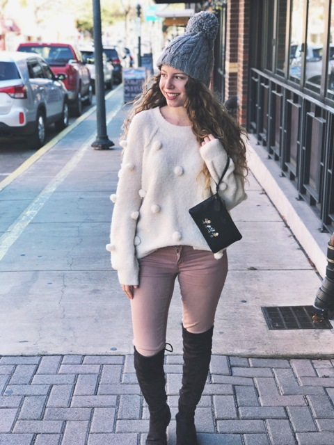 With skinny pants, gray hat, black clutch and suede over the knee boots