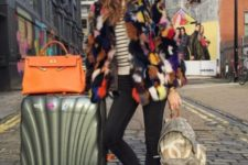 With striped shirt, jeans and colorful fur coat
