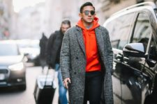 With sunglasses, gray coat and black pants