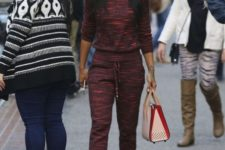 With sweatshirt, sporty pants and pale pink and red bag