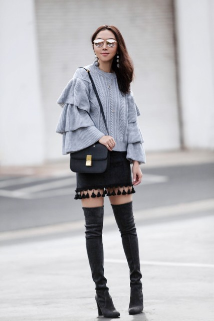 With tassel skirt, black bag and dark gray boots