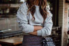 With tweed ruffled skirt and embellished mini bag