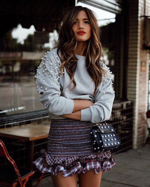 With tweed ruffled skirt and embellished mini bag