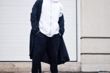 With white hoodie, navy blue coat and navy blue pants