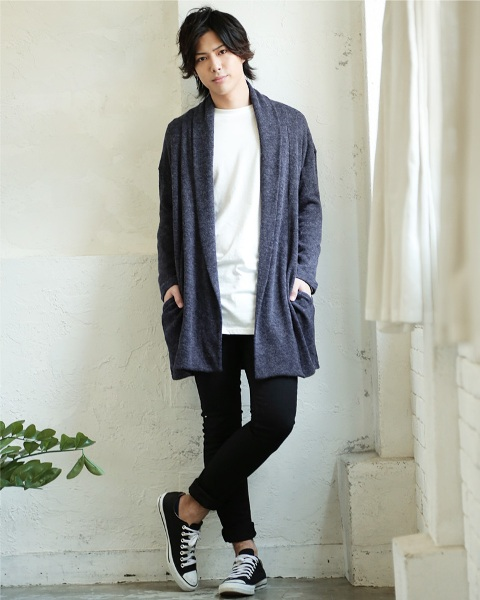 With white long shirt, black cuffed pants and white and black sneakers