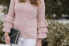 With white pants and patent leather clutch