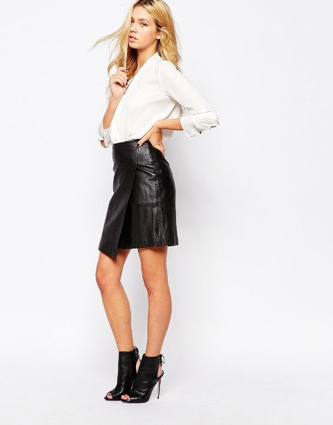 With white shirt and cutout boots