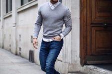 With white shirt, cuffed jeans and lace up boots