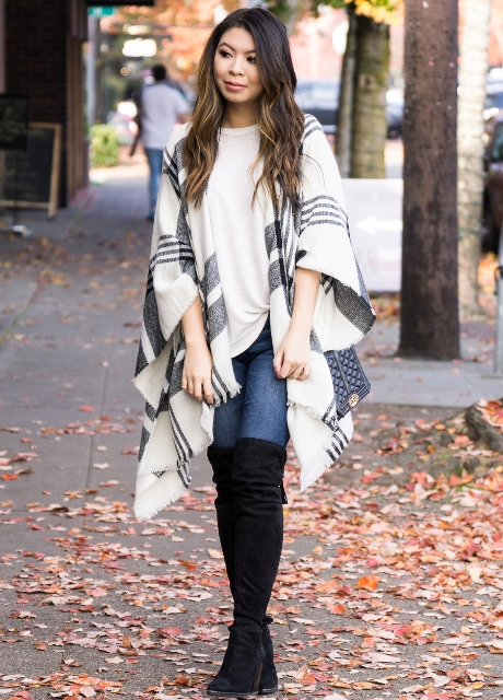 With white shirt, jeans and black high boots