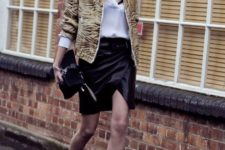 With white shirt, printed jacket, black clutch and platform shoes