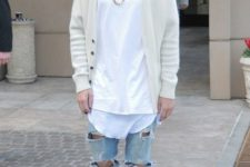 With white t-shirt, beige cardigan, cap and distressed jeans