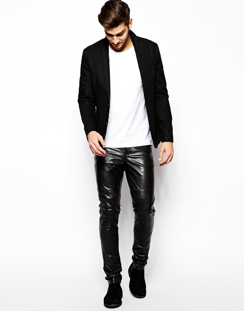 With white t-shirt, black blazer and black boots