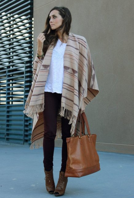 With white t-shirt, black skinny pants, brown leather tote and cutout boots