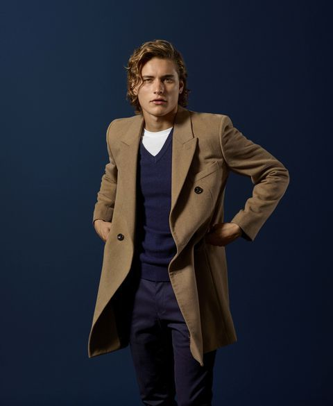 With white t shirt, brown coat and trousers
