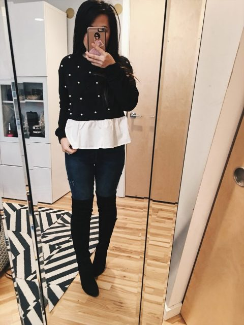 With white t-shirt, jeans and black over the knee boots