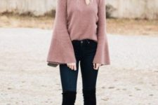 With wide brim hat, jeans and black high boots