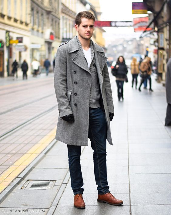 a casual look with navy jeans, cognac shoes, a white tee and a grey cardigan, a grey coat and black gloves
