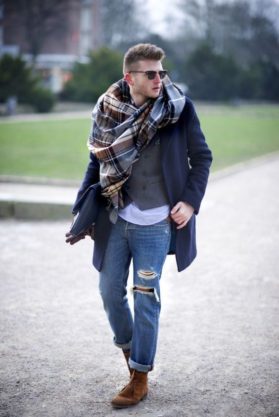 a stylish look with ripped denim, cognac boots, a white tee, a grey waistcoat, a plaid scarf and a navy short coat