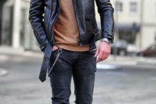 an outfit with a touch of rock, black jeans, a camel turtleneck, camel boots, a black leather jacket with a fur collar