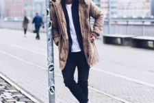 black jeans, a white tee, a black cardigan, white sneakers and a camel puffer coat with fur