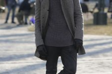 black jeans, grey boots, a grey sweater, a printed scarf and a grey coat plus gloves for a casual feel