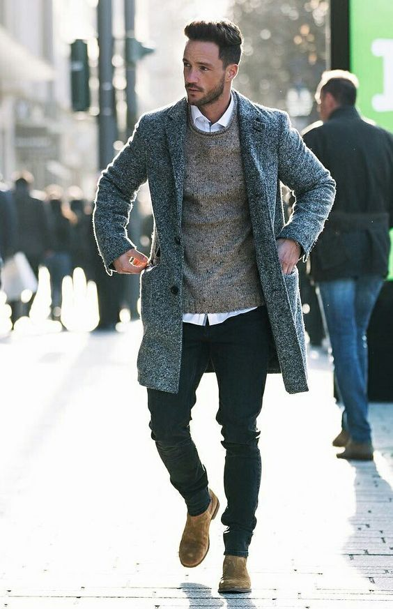 black skinnies, a white shirt, a brown sweater, a grey coat and beige boots