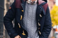 blue jeans, a plaid shirt, a grey cable knit sweater, a navy and burgundy coat with a hood