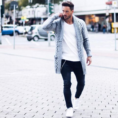 With white shirt, jeans and white sneakers