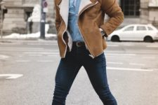 navy jeans, a white tee, a denim shirt, beige boots and a camel shearling coat