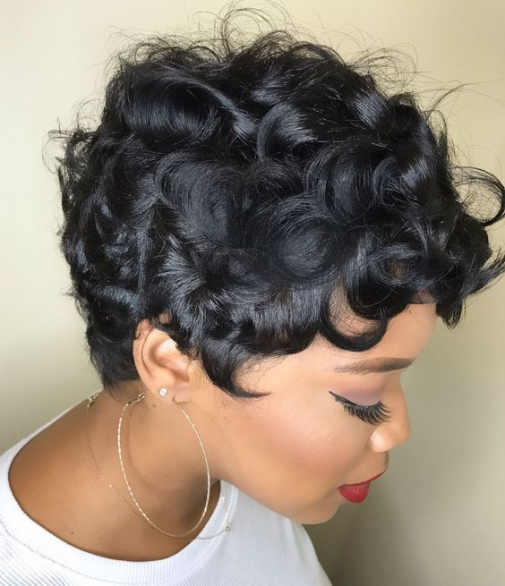 a curly piecey pixie haircut on African hair looks really amazing