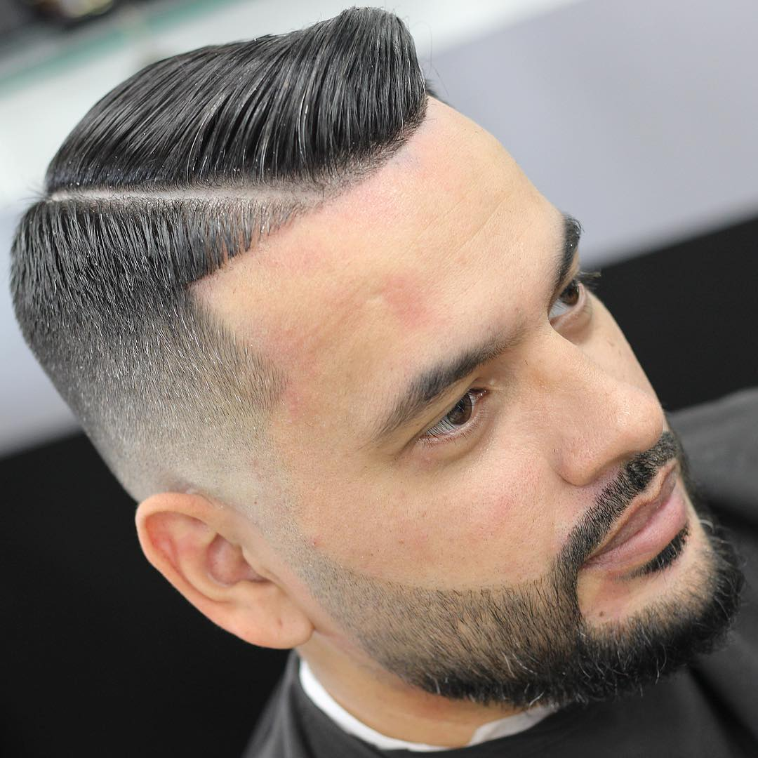 a hard part plus a line up is a bold and edgy idea to rock with a beard or without any