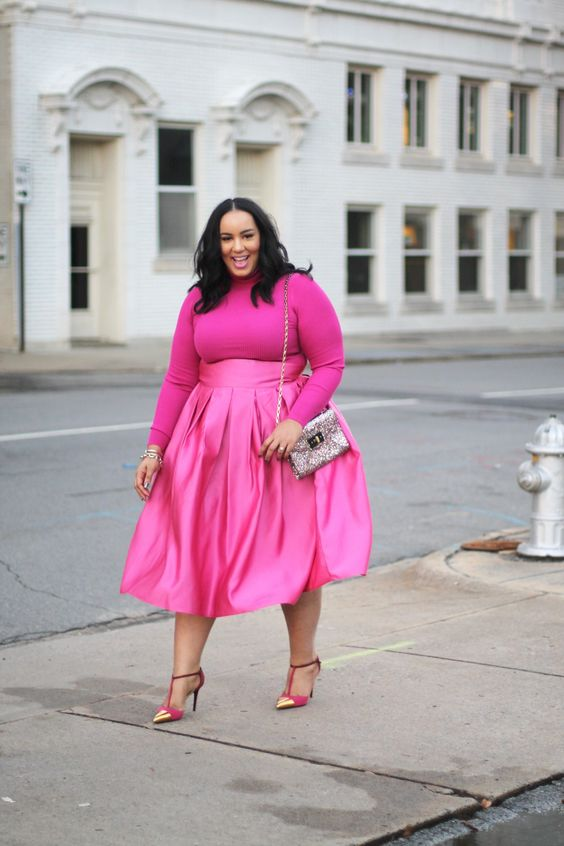 a hot pink Valentine's Day outfit with a turtleneck, an A-line midi pleated skirt and pink and gold shoes