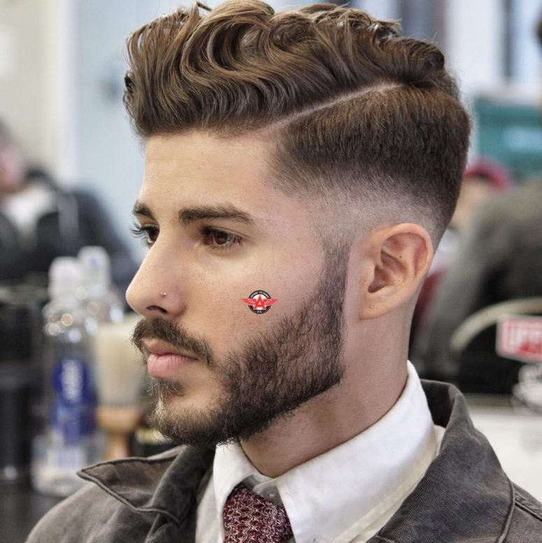 a side part haircut and a low fade is a popular idea that shows off amazing volume
