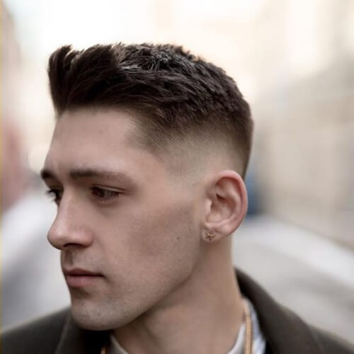 a spiked up back medium top and a trimmed mid fade haircut is a bold idea for guys who prefer shorter hair