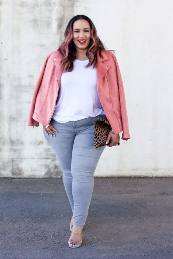 a bright curvy girl's look in a pink leather jacket, grey skinnies, a white t-shirt, and grey heels