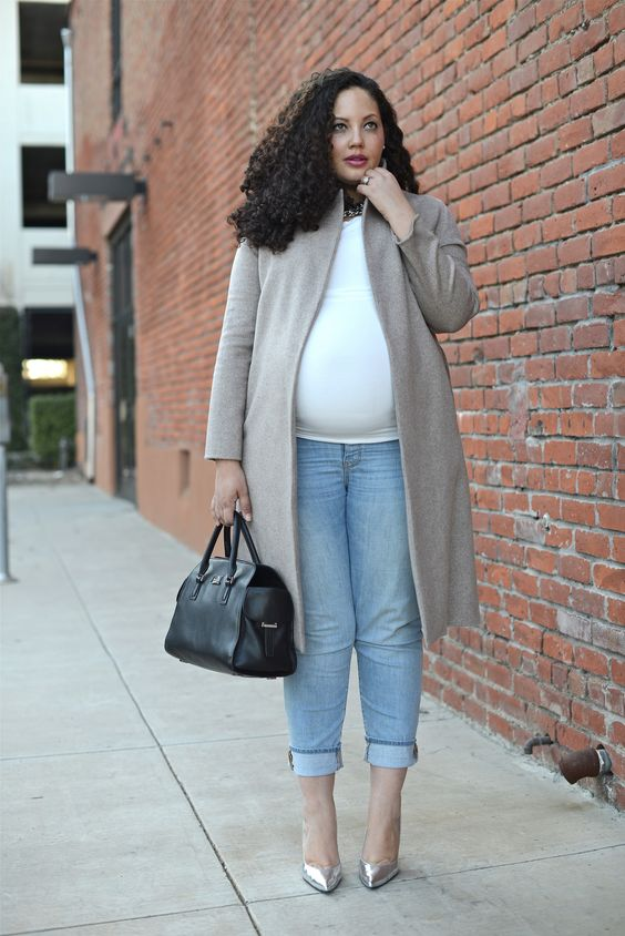 light blue cropped skinnies, a white tee, metallic shoes, a grey coat, a black bag