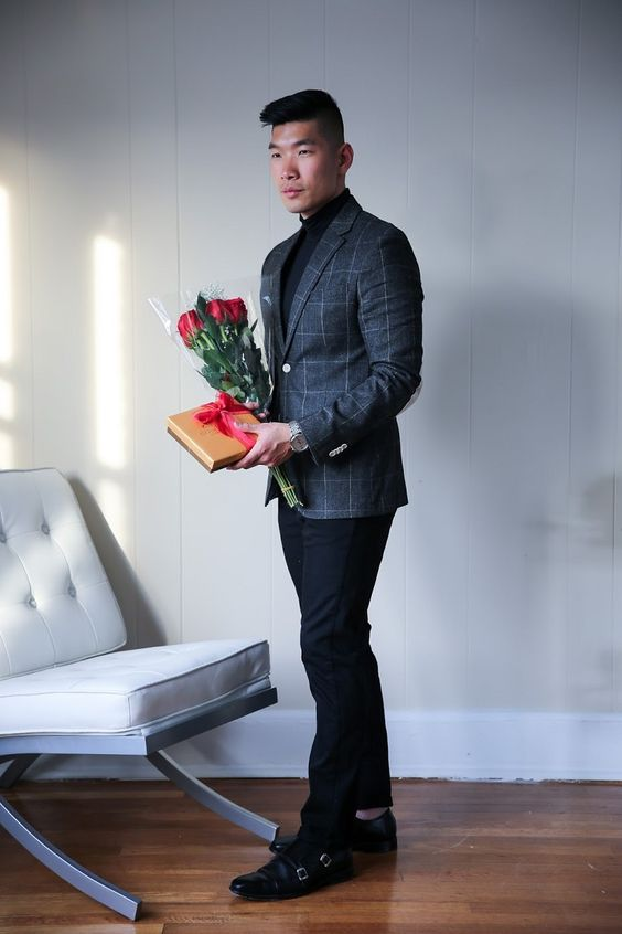 a black turtleneck, black pants and shoes and a grey windowpane print blazer for a formal date