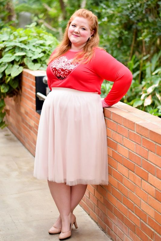 a long sleeve top with a sequin heart, a blush midi and nude shoes