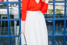 03 a red long sleeve top with a V-neckline, a neutral midi skirt, grey heels and a black bag