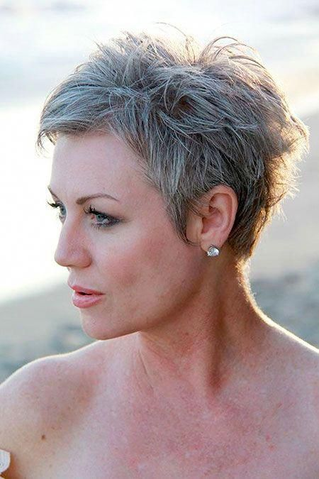 a short pixie textural haircut with grey hair looks bold and chic