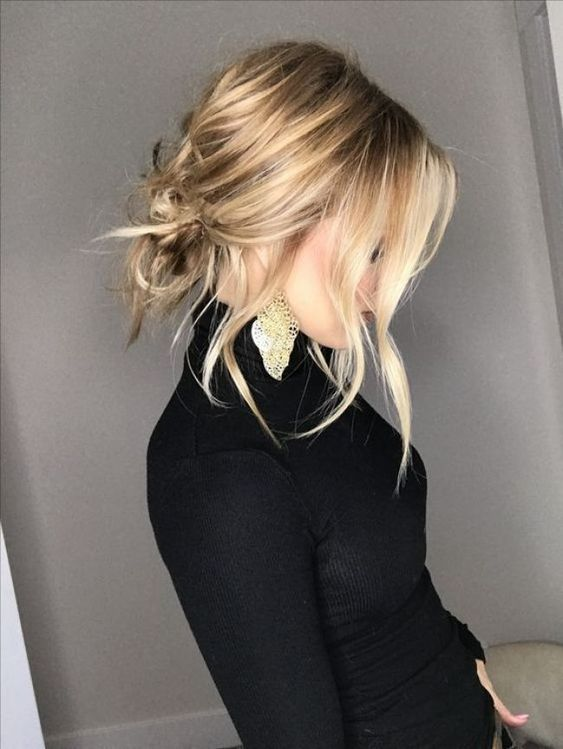 a super messy low bun with wavy bangs and a bump can be done on medium length hair