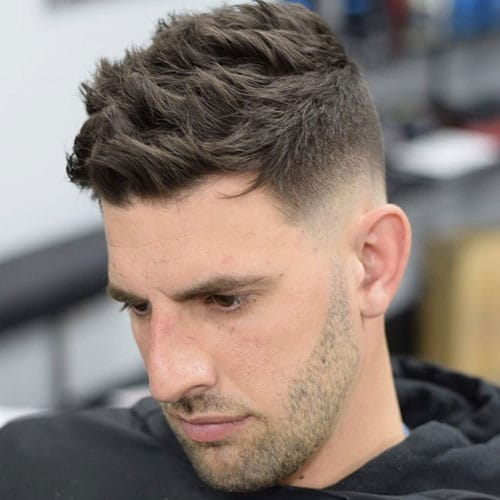 a textured crew cut and nid fade sides create a bold modern look