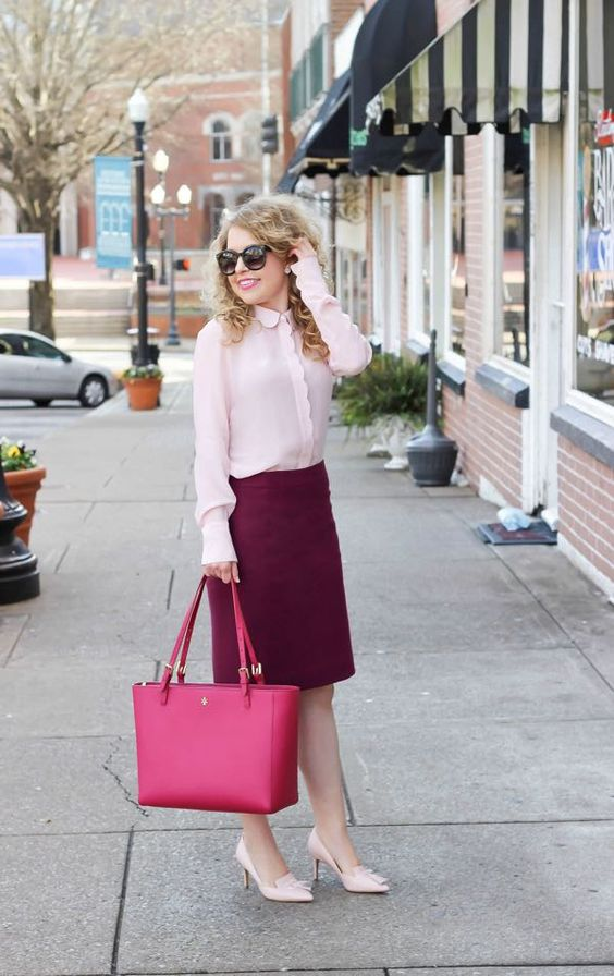 a blush shirt, a purple over the knee skirt, blush shoes and a pink bag for a bold outfit