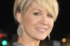 04 a longer pixie haircut with bangs and a slight balayage looks very elegant and sassy
