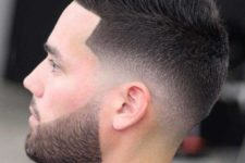 04 a low skin fade with a line up and a beard is a chic idea to wear
